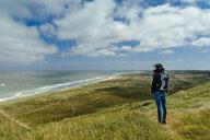 Denmark, Jutland, woman standing in dune landscape - UMF00876
