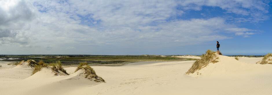 Denmark, Jutland, woman enjoying the view at Rabjerg Mile shifting dune - UMF00909