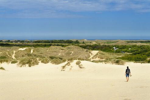 Denmark, Jutland, woman walking at Rabjerg Mile shifting dune - UMF00912