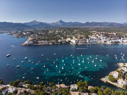 Spain, Baleares, Mallorca, Calvia region, Aerial view of Santa ponca, marina, Serra de Tramuntana in the background - AMF06653