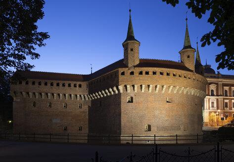 Poland, Krakow, Barbican fortification at night, medieval city landmark - ABOF00396