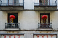 Detail of facade with balconies and red lamps - ASTF01796
