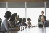 Businesswoman leading meeting in conference room - HEROF04169