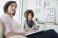 Businesswomen working in office - HEROF04220