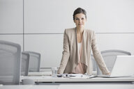 Portrait of confident businesswoman in conference room - HEROF04385