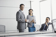 Portrait of confident business people in conference room - HEROF04388