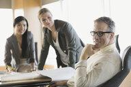 Portrait of confident businessman in meeting - HEROF04400