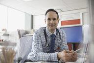 Portrait of confident doctor in office - HEROF04451