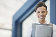 Portrait of confident businesswoman with digital tablet - HEROF04472