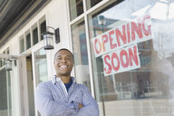 Portrait of business owner standing at new storefront - HEROF04586