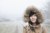 Portrait of teenage girl surrounded by mist in Blekinge, Sweden - FOLF09728