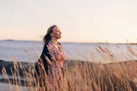 Woman at beach in Blekinge, Sweden - FOLF09755