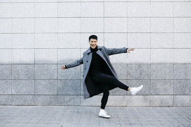 Stylish young man dancing on the street - JRFF02466