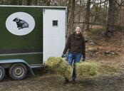 Woman carrying hay bales - FOLF09927