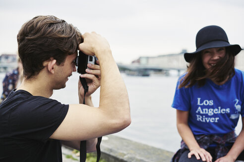 Young man taking a photo of a mid adult woman in Copenhagen, Denmark - FOLF09933