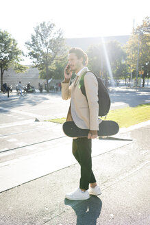 Spain, Barcelona, men using a skate board in the city, urban mobility skateboard men young city handsome transportation alternative - VABF02093