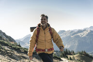 Austria, Tyrol, happy man hiking in the mountains - UUF16335