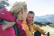 Austria, Tyrol, happy couple having a break during a hiking trip in the mountains - UUF16359