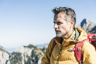 Austria, Tyrol, portrait of man on a hiking trip in the mountains - UUF16374