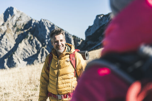 Austria, Tyrol, happy man with woman hiking in the mountains - UUF16383