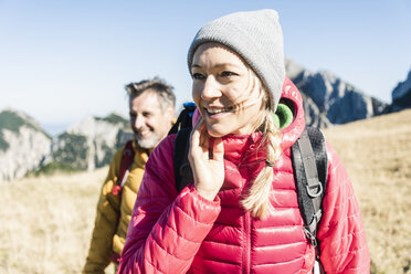 Austria, Tyrol, smiling couple hiking in the mountains - UUF16389