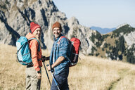 Austria, Tyrol, happy couple on a hiking trip in the mountains - UUF16401