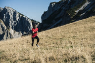 Austria, Tyrol, man running in the mountains - UUF16413