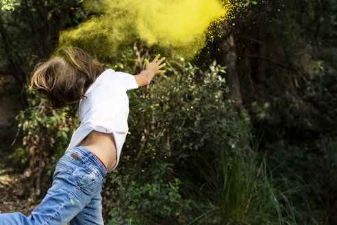 Boy throwing colorful powder paint, celebrating Holi, Festival of Colors - ERRF00445