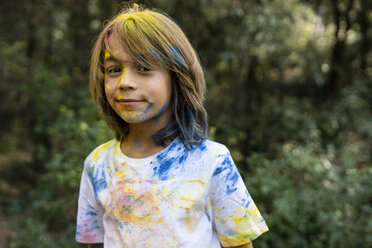 Boy full of colorful powder paint, celebrating Holi, Festival of Colors - ERRF00454