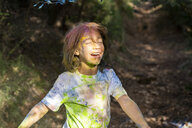 Boy full of colorful powder paint, celebrating Holi, Festival of Colors - ERRF00457