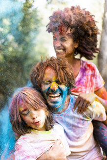 Family full of colorful powder paint, celebrating Holi, Festival of Colors - ERRF00466
