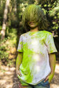 Boy full of colorful powder paint, celebrating Holi, Festival of Colors - ERRF00490