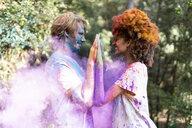 Affectionate couple celebrating Holi, Festival of Colors - ERRF00511