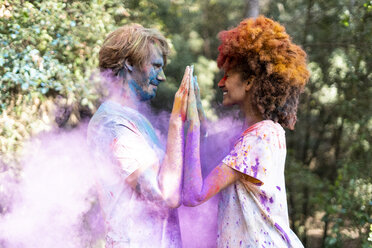 Affectionate couple celebrating Holi, Festival of Colors - ERRF00511