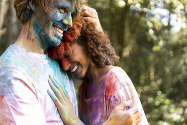 Affectionate couple celebrating Holi, Festival of Colors - ERRF00514