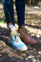 Shoes of a person covred in powderb paint, celebrating Holi, Festival of colors - ERRF00526