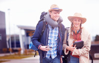 Backpacker couple at airport - CUF46570