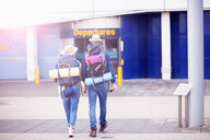 Backpacker couple entering airport - CUF46573