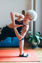 Woman practising yoga at home - CUF46687