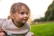 Child sitting on grass in park - CUF46810