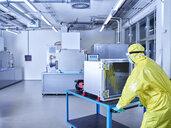 Chemist working in industrial laboratory clean room - CVF01095