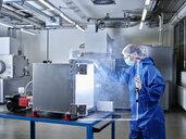 Chemist working in industrial laboratory clean room - CVF01098