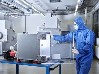 Chemist working in industrial laboratory clean room - CVF01101