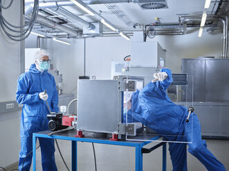 Chemists working in industrial laboratory clean room - CVF01104