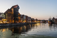 Poland, Gdansk, Hanseatic League houses and Crane House on the Motlawa river at dusk - RUNF00898