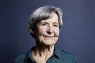Portrait of smiling senior woman - RBF06998