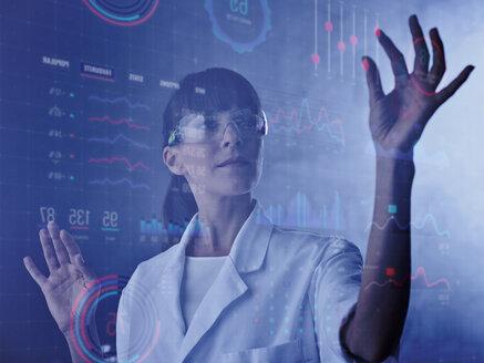 Scientist operating digital screen in a laboratory - CVF01114
