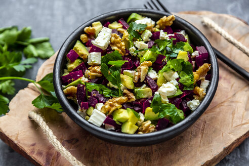 Bowl of beetroot salad with avocado, feta, walnuts and parsley - SARF04054