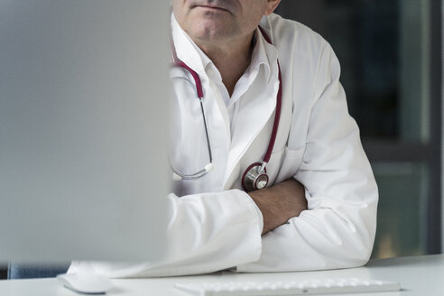 Close-up of doctor in medical practice at desk - JOSF02776