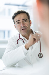 Portrait of doctor talking to patient in medical practice - JOSF02782